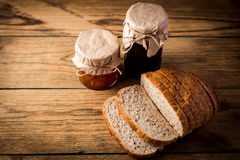 Bread and orange homemade jam on wooden table Royalty Free Stock Photos