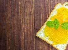 Bread and orange jam Royalty Free Stock Photo