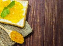 Bread and orange jam Stock Image