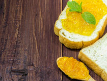 Bread and orange jam Royalty Free Stock Images
