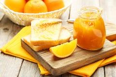 Bread and orange jam Royalty Free Stock Photos