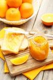 Bread and orange jam Stock Photography