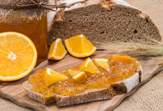 Bread with Orange Jam (rustic background) Stock Image