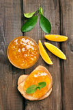 Bread and orange jam, top view Stock Photos