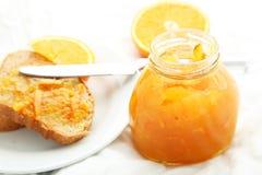 Bread with orange jam Stock Photo