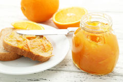 Bread with orange jam Royalty Free Stock Images