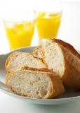 Bread and orange juice Royalty Free Stock Photos