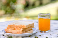 Bread and orange juice Stock Images