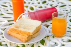 Bread and orange juice Stock Photography