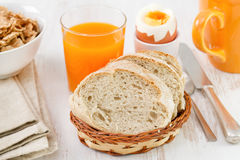 Bread with orange juice, cereals, egg. And cup Stock Photography