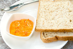Bread with orange marmalade jam Royalty Free Stock Photography