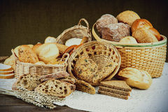 Bread and other baked food in wooden table Stock Image