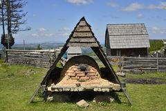 Bread oven and mountain house. Royalty Free Stock Photo