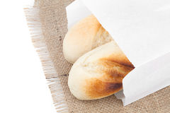 Bread packaged in a paper bag Royalty Free Stock Images