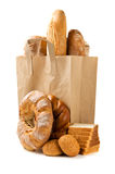Bread in a paper bag isolated. On the white background royalty free stock photo