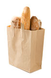 Bread in a paper bag isolated Stock Image