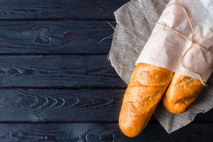 Bread in a paper bag on a napkin Royalty Free Stock Photography