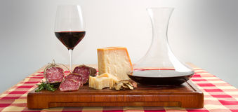 Bread parmesan cheese  salami and wine. Some bread parmesan cheese  salami and red  wine Stock Photos