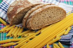 Bread and pasta with complex carbohydrates. Complex carbohydrates products on the table with a napkin royalty free stock image