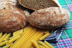 Bread and pasta with complex carbohydrates. Complex carbohydrates products on the table with a napkin royalty free stock images