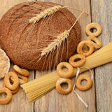 Bread, pasta and pastries on a wooden surface Royalty Free Stock Image