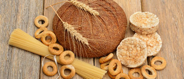 Bread, pasta and pastries on  wooden surface. Bread, pasta and pastries on a wooden surface Stock Images