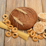 Bread, pasta and pastries on wooden surface. Bread, pasta and pastries on a wooden surface Royalty Free Stock Photography