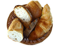 Bread and pastries. French bread and pastries in a wicker basket, isolated on a white background Royalty Free Stock Images