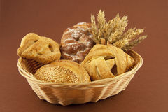 Bread and pastries on a basket Royalty Free Stock Image