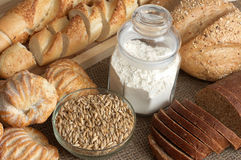 Bread, pastries, grains and pot with meal Royalty Free Stock Photo