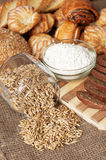 Bread, pastries, meal and pot with grains Stock Photo