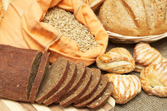 Bread, pastries and sack with grains Stock Images