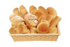 Bread and Pastry assortment. In the basket isolated on white background Stock Photos