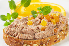 Bread with pate. Close up of bread slice with meat spread and pieces of orange Royalty Free Stock Photography