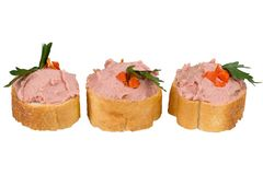 Bread with pate and herbs on a white background Royalty Free Stock Images