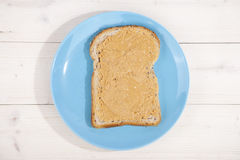 Bread with peanut butter on wooden background Stock Image