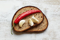 Bread with pepper and garlic Stock Images