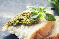 Bread with pesto, basil  on a wooden background Stock Photo