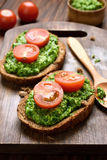 Bread with pesto sauce and tomatoes Stock Images