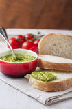 Bread with pesto on a wooden background. Royalty Free Stock Photo