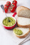 Bread with pesto on a wooden background. Royalty Free Stock Image