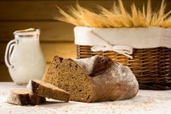 Bread and pitcher of milk Royalty Free Stock Images