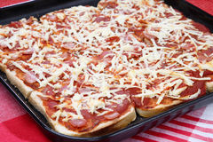 Bread pizza in backing pan. On table Royalty Free Stock Images