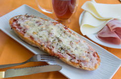Bread pizza with ham and cheese Stock Image