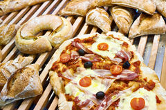 Bread and pizza on a wooden counter of cafe Royalty Free Stock Images