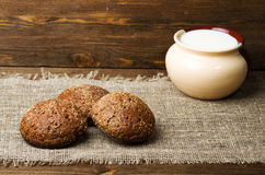 Bread placed on a wooden slope in the background Stock Image