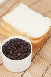 Bread plate and cup with coffee beans. Royalty Free Stock Photography