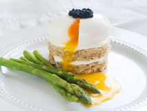 Bread with poached egg with asparagus Royalty Free Stock Photo