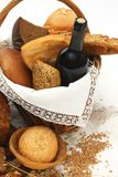 Bread products and wine in basket Stock Image
