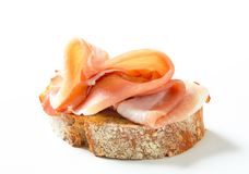 Bread with prosciutto Stock Photography